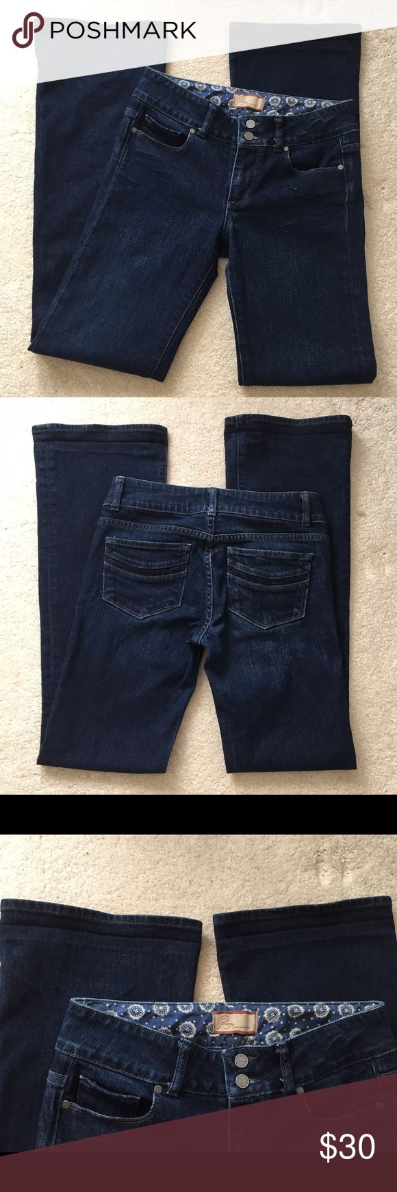 """Paige Hidden Hills high rise bootcut jeans 26/27 This is a beautifully unique sample pair that I'm so sad I'll never fit into again! 😢 it's the hidden hills high rise bootcut. Mightnight wash. **It does not have the size tag, but fits like a 26 (maybe a small 27). This is an older pair in EXCELLENT CONDITION. Still needs to be broken in!  *The only wear is some creasing/slight lightening at the hems from when I fold hemmed it, but otherwise perfect! Measurements: waist: 14"""", rise: 8.5""""…"""