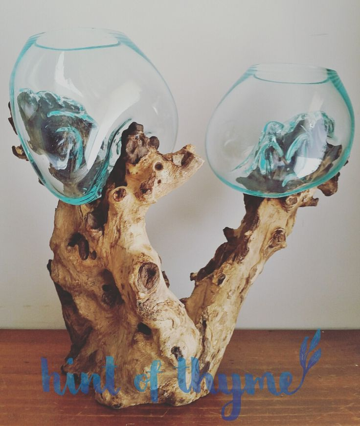Handmade blown glass bowl on a natural teak wooden base. Double set with two glass bowls on one piece of wood. 'Large' size. Each item is unique as they are made from natural wood.