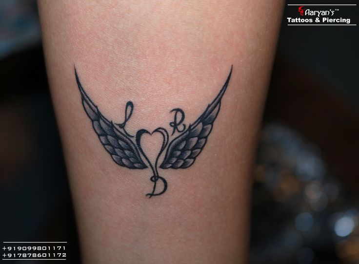 When wing (love) is in the air, then why not on your body?(Express to family) Small Beautiful wing with initial  tattoo design at Aaryans Ahmedabad. Call/Whatsapp for appointments: 9099801171. #Safe, #Sterile, #Gentle, #Hygienic. Most Experienced Tattoo Artist in Gujarat.