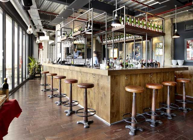 Industrial inspired bar interior design
