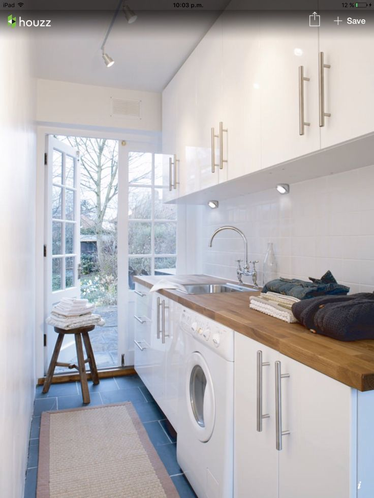 White laundry cupboards, timber bench