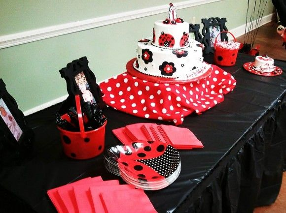 Ladybug party ideas cake table red and black