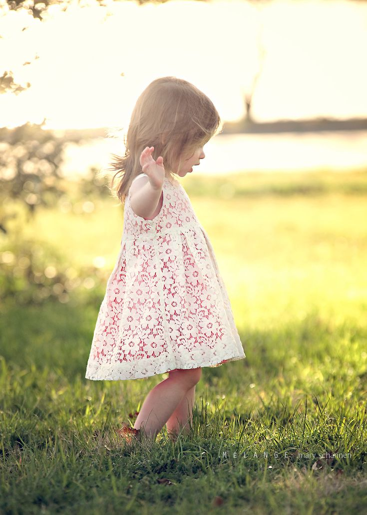 Adorable Little Girl Wearing A Pink Dress With A Lace