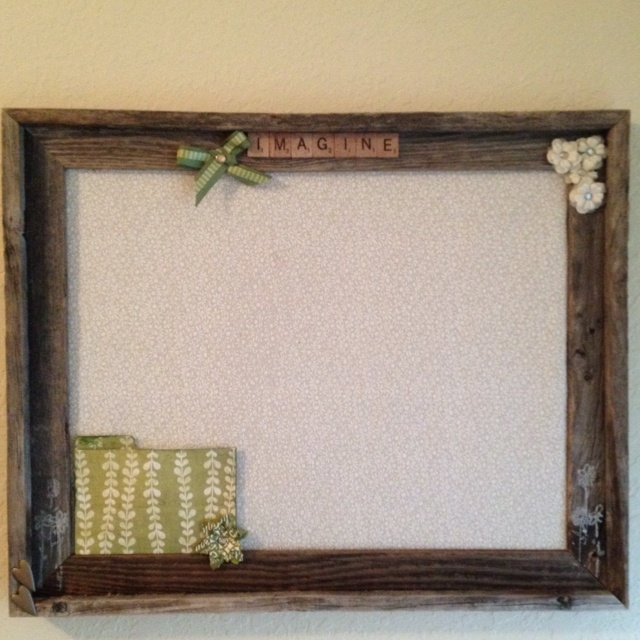 Homemade bulletin board! (cork board is underneath the fabric)