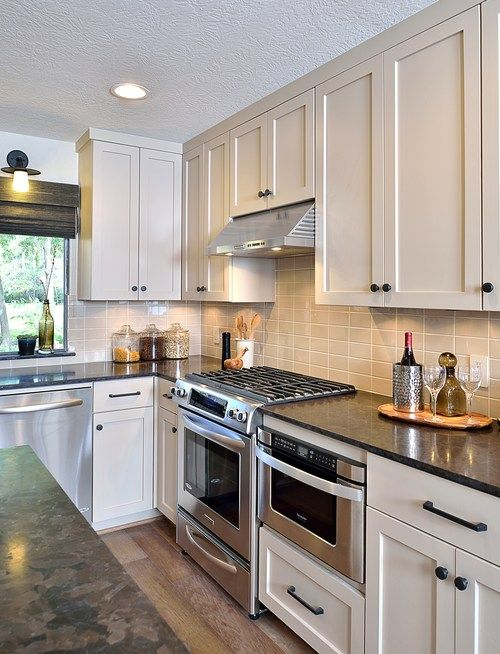 LOVE THESE COLORS NOTE FLOOR, COUNTERS, CABINETS AND THOSE GORGEOUS HANDLES