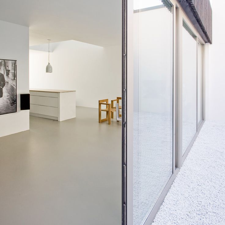 A central lightwell and a secluded courtyard bring natural light into the heart of this house in Leiden, the Netherlands, which was designed by Pasel Kuenzel for a photographer and his family.
