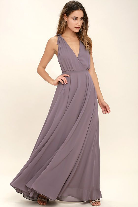 Every twirl you take in the Dance the Night Away Dusty Purple Backless Maxi Dress will be absolutely magical! Woven poly forms wide straps, with tying detail and hidden no-slip strips, that flow into a surplice bodice. A sweeping maxi skirt falls below a backless silhouette and fitted waist. Hidden back zipper/clasp.