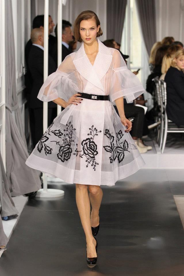 DIOR SPRING-SUMMER 2012  Look No. 1  Embroidered white silk coat.    Model : Karlie Kloss