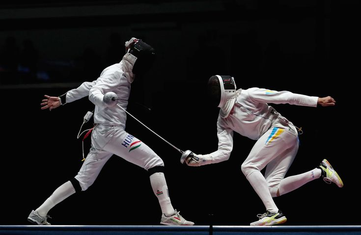 Andras Redli of Hungary competes against Anatolii Herey of Ukraine during the Men's Epee Team Bronze Medal Match on Day 9 of the Rio 2016 Olympic Games at the Carioca Arena 3 on August 14, 2016 in Rio de Janeiro, Brazil.