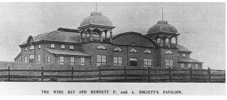 Wide Bay and Burnett Pastoral and Agricultural Society's Pavilion, 1905  The large show pavilion has a belvedere on the roof at each side of the main entrance. These structures have a domed roof