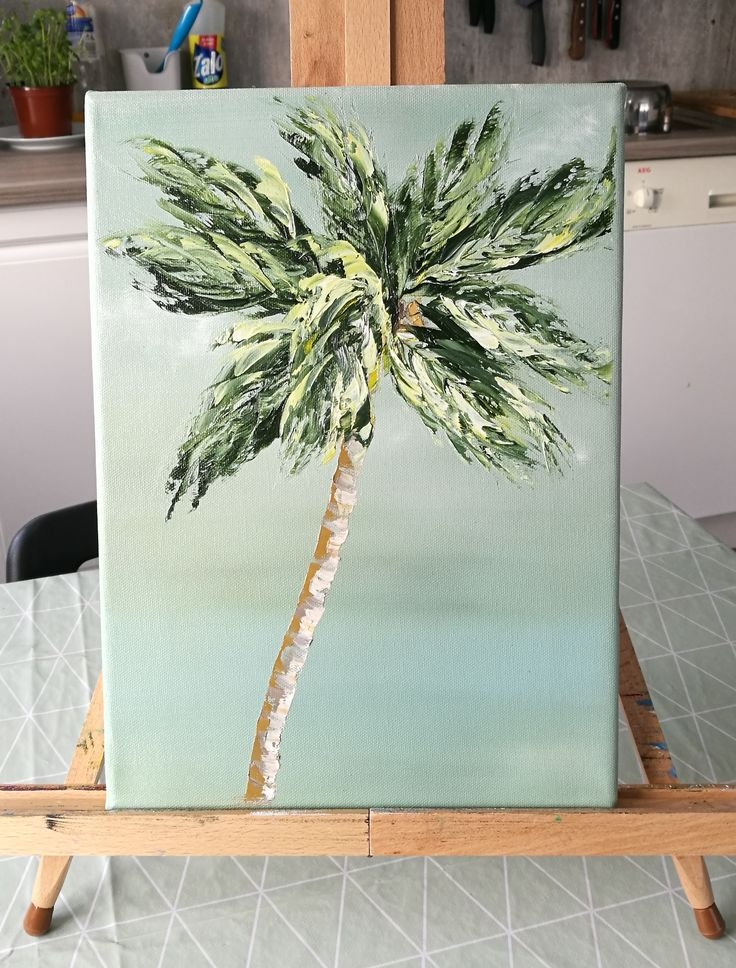 A palette knife palm tree with a green background. Painted with water soluble oil paint.