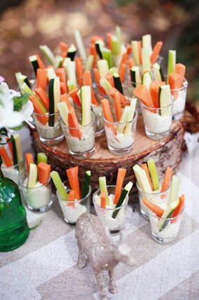 rustic nature inspired woodland baby shower with tree backdrop vegetable dip cups