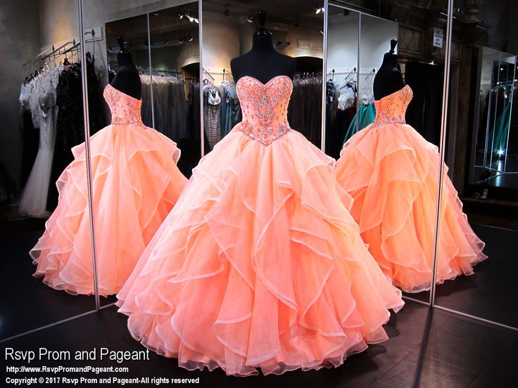 You will look like a princess in this gorgeous strapless coral ball gown! Check it out at Rsvp Prom and Pageant, your source of the HOTTEST Prom and Pageant Dresses!!