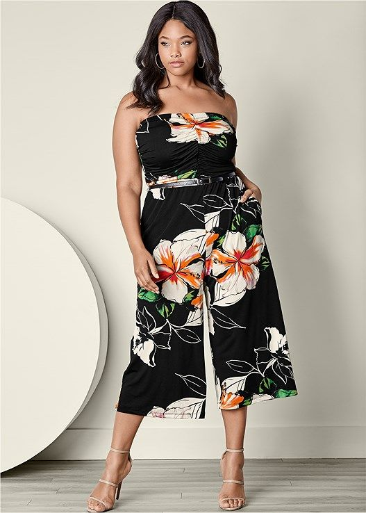 ab53c968a1b35 Tap into your romantic side with dark florals in this Strapless Culotte  Jumpsuit.