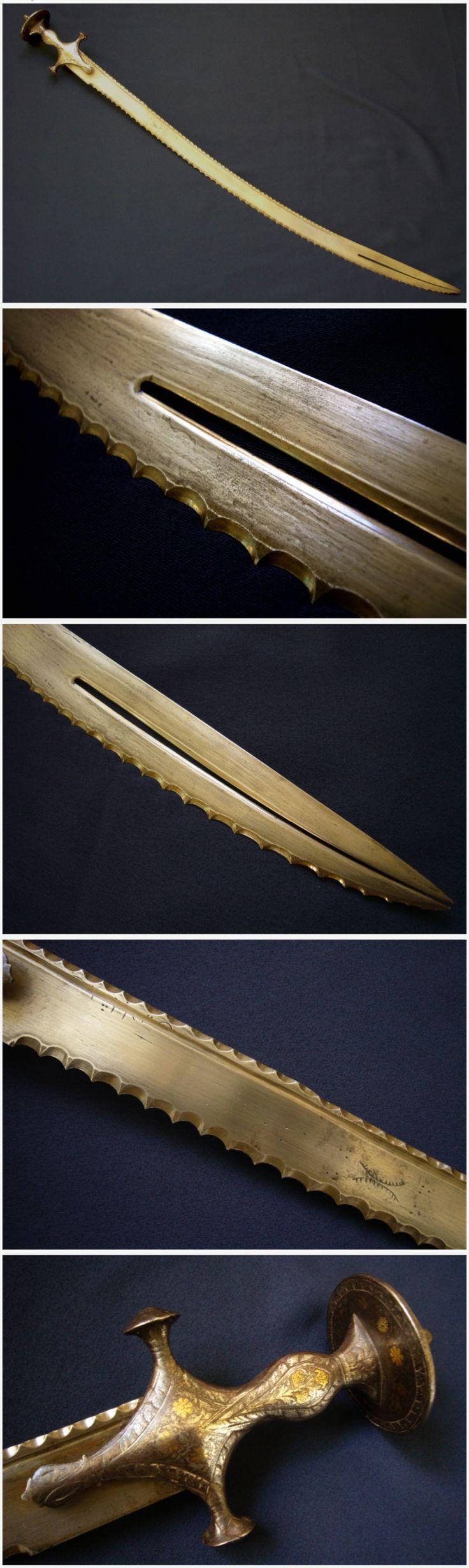 Indian zulfikar / zulfiqar (split tip) sword with serrated blade and tulwar hilt.