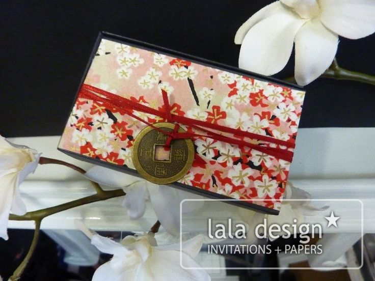 Red ribbon with chinese embellishment box