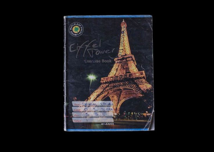 """This image was taken by Glenna Gordon and is a part of her """"Abducted Nigerian School Girls"""" series. I really like this photo in the series because I think it is really nice to see how one of the school girls work books had an image of the Eiffel Tower on it. To me this shows that the girls had big dreams of travel and adventure, which in turn makes it a much more powerful image once you realise that she has been kidnapped."""