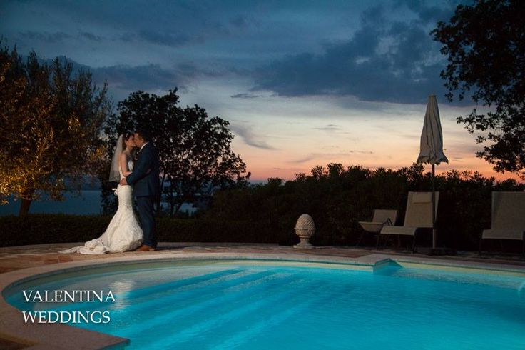 At the end of the day it's so romantic to find the bride and the groom kissing around the panoramic pool of Villa San Crispolto.... surrounded by a magical sunset! Photos by Valentina Weddings