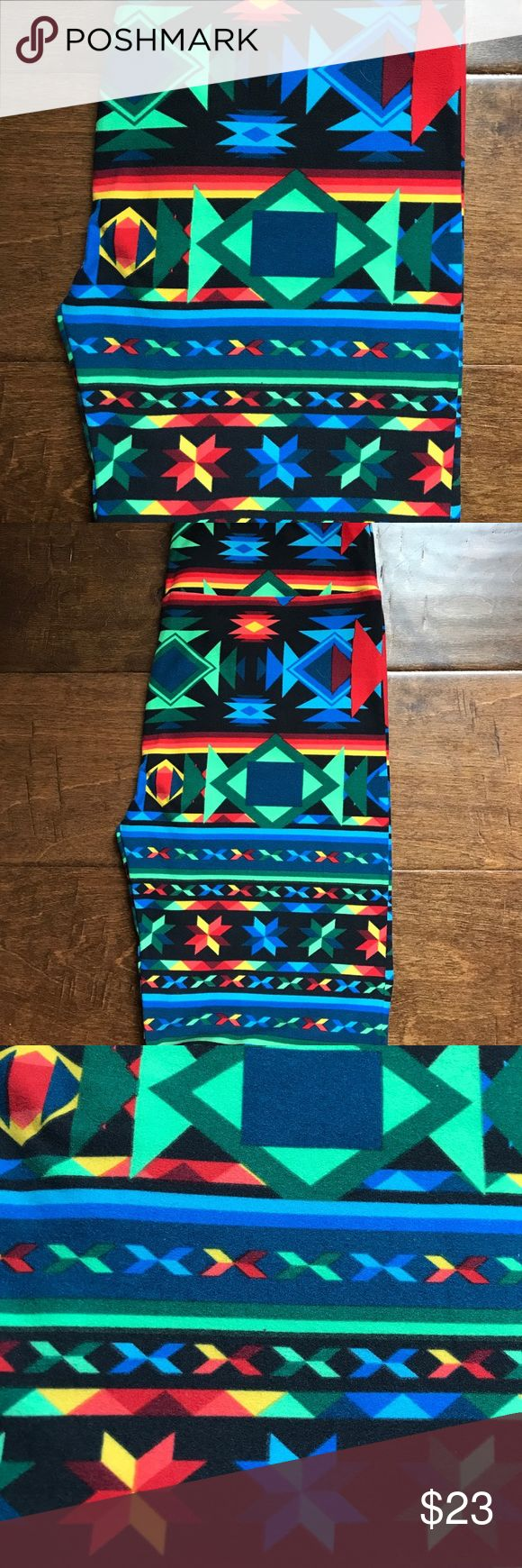 LuLaRoe Aztec Tribal Print OS Leggings These brand new, never worn LuLaRoe leggings are so cool - gorgeous tribal/Aztec print and so versatile... not to mention SOFT!  these are One Size and will fit sizes 0 - 12. Feel free to make an offer! LuLaRoe Pants Leggings