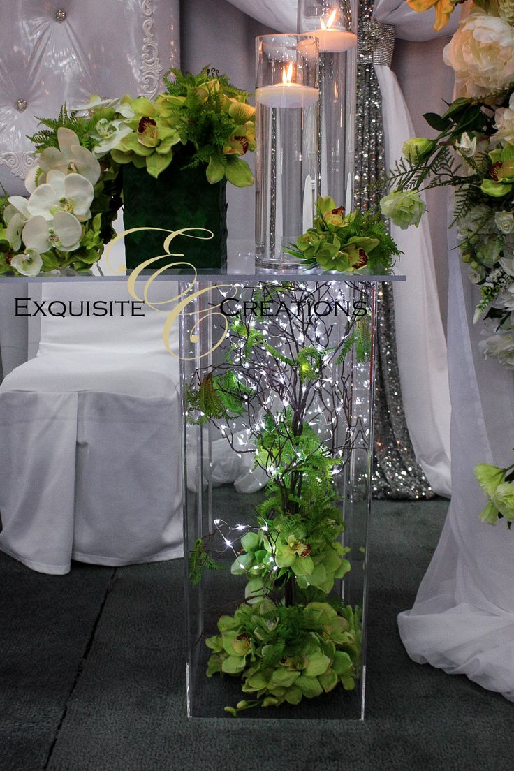 Tree branch centerpiece with green flowers and LED lights