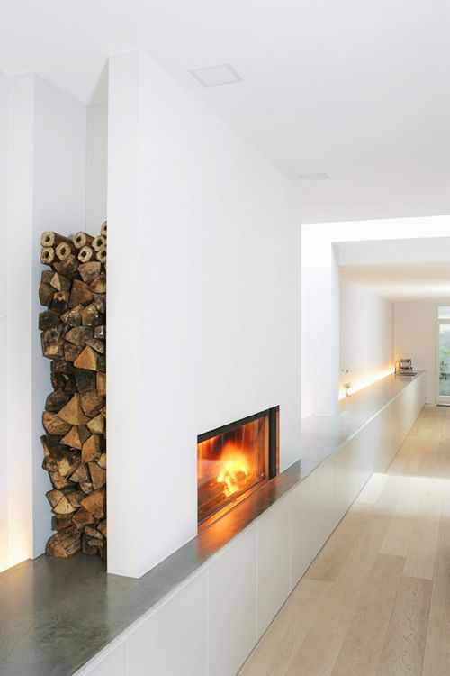 Home Decor for a modern fireplace with storage.