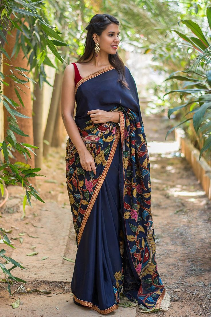 We can never get enough of Kalamkari patch works. This navy blue pure crepe beauty is an ode to our love. The brocade red border adds a touch of bling to the otherwise simple ethnic saree. The picturesque kalamkari patchwork that works a story on its own takes the saree to a different level of sophistication. Complement her with a red velvet blouse and you are sorted. ACCOMPANIMENTS: All sarees are sold completely finished with falls (where required) and a free size underskirt.  FABRIC…