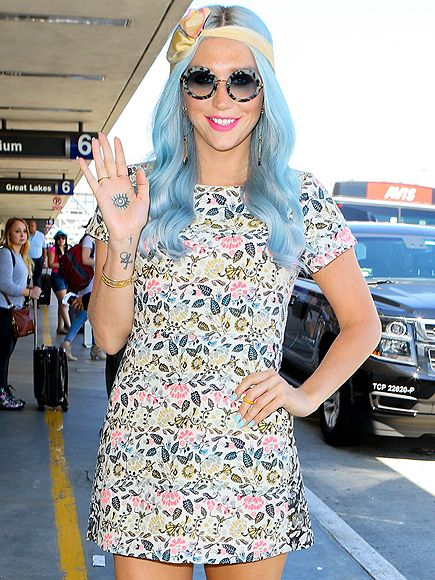 Ke$ha transported her style back to the '70s by rockin' cotton candy tresses, hippy-inspired round sunnies with blue tinted lenses and a vintage floral frock!
