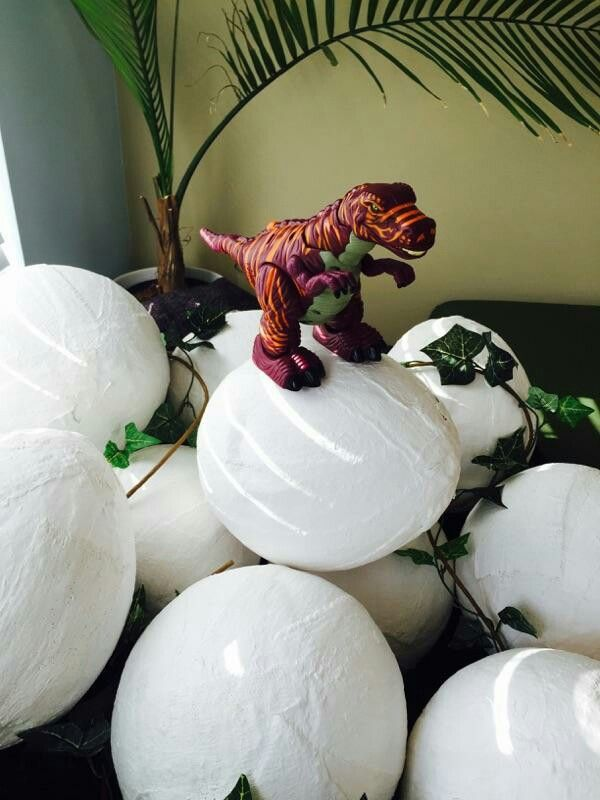 Paper mache dinosaur eggs! Hubby made them and filled them with goodies instead of handing out regular goodie bags:)
