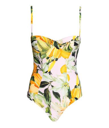 Yellow/patterned. Fully lined swimsuit with a printed pattern. Padded underwire cups, tie at back, and adjustable, detachable shoulder straps. High-cut legs