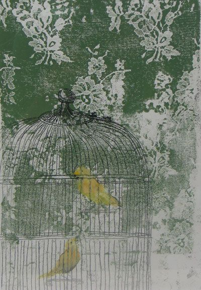 canaries in a bird cage in front of green wallpaper