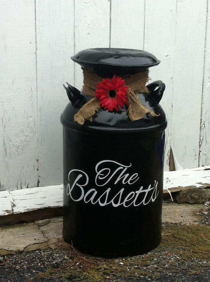 I fixed up this milk can for a friend. Sanded down the milk can with a wire brush, spray painted with rust coat paint, added some burlap a gerber daisy and stencils.  Voila!!