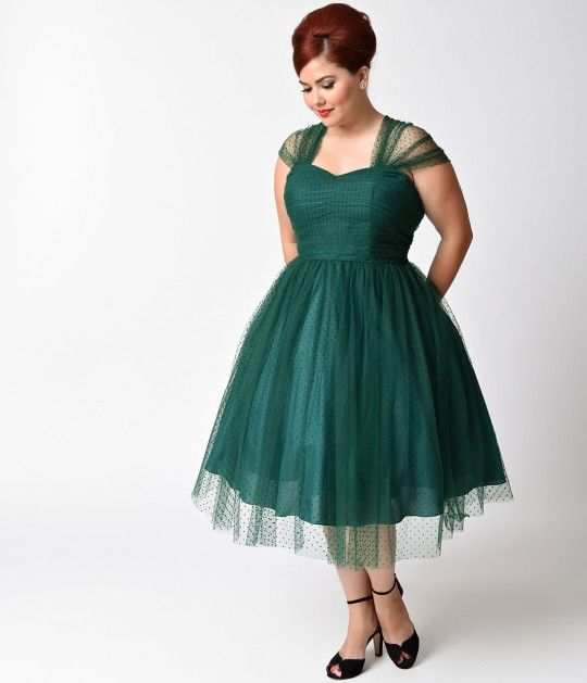 Perfect for your next garden party or afternoon tea, this retro emerald green swiss dotted plus size dress will give you a feminine look thats straight out of the 1950s. The green A-line shape is flattering on any womans figure, as its cinched waist sli