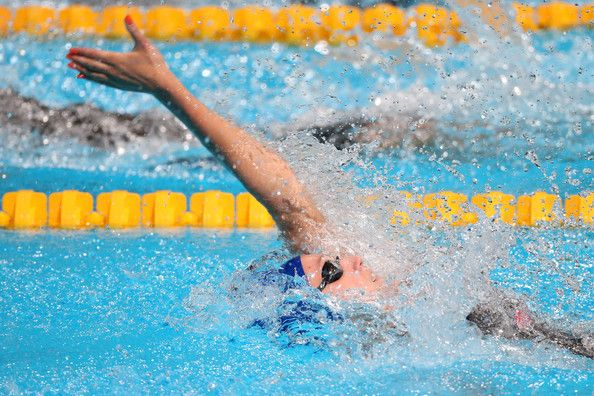 Georgia Davies of Great Britain competes during the Women's 100m Backstroke Preliminaries heat five on day ten of the 15th FINA World Championships at Palau Sant Jordi on July 29, 2013 in Barcelona, Spain.