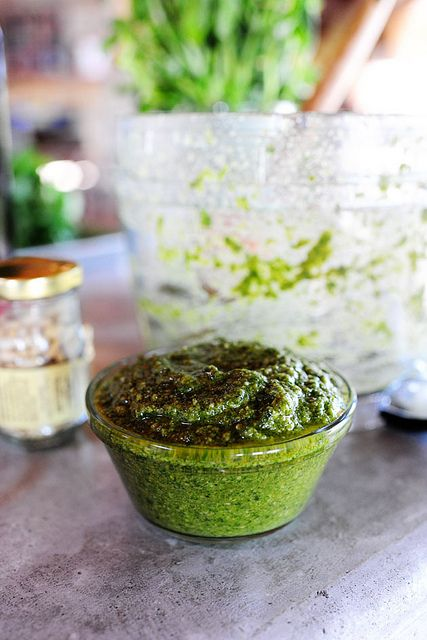 PESTO :: Add about a cup of basil leaves to a food processor or blender. Throw in grated Parmesan, pine nuts, garlic, salt, and pepper. Turn on the food processor and drizzle in enough olive oil to get it to the consistency you want.
