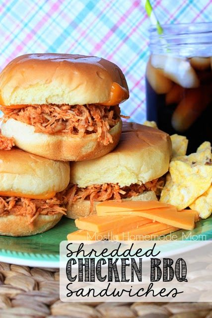 Shredded chicken simmers away in a homemade, tangy BBQ sauce and served over toasted potato rolls!