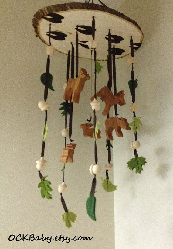 BUCKS, TRACKS & RUBS™ Hardwood Baby Mobile    Stimulate your babys senses with this beautiful handcrafted hardwood baby mobile. The differing colors and