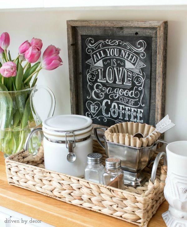 Small coffee station made by corralling supplies in a woven tray (love the trophy cup holding the coffee filters!)