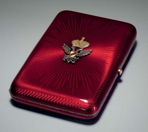 A Silver Gilt and Enamel Cigarette Case  Marked Fabergé, workmaster's mark of August Hollming, St. Petersburg, circa 1910 Rectangular with rounded corners, enameled translucent strawberry red over a sunburst guilloché ground, the cover applied with a crowned double-headed eagle, marked inside cover 3½ in. (8.9 cm.) long