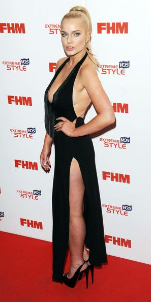 Helen Flanagan Lookbook: Helen Flanagan wearing Halter Dress (7 of 7). Helen Flanagan chose a super sexy red carpet look when she chose this V-neck gown with a fringe detailed neckline and a side slit.