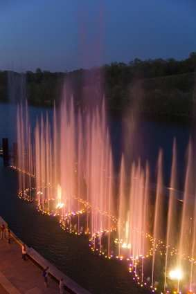 Branson, Missouri: Branson Landing,  fountain 'Fire & Water Show.' ~ Nestled against Lake Taneycomo, Branson Landing features a scenic boardwalk along the 1.5 mile lakefront, over 100 specialty stores & 26 dining options. Beginning at noon each day the Lake Taneycomo lakefront erupts w/ a spectacular fountain show featuring water, light, fire & music w/ a special 2 show presentation at 7pm.