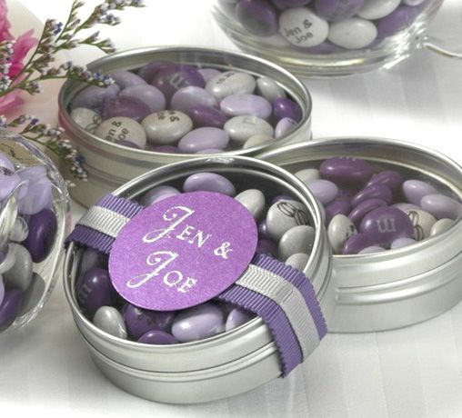 DIY wedding favors from M - you can special order any color or imprint. Gold tins with white and beige m&ms