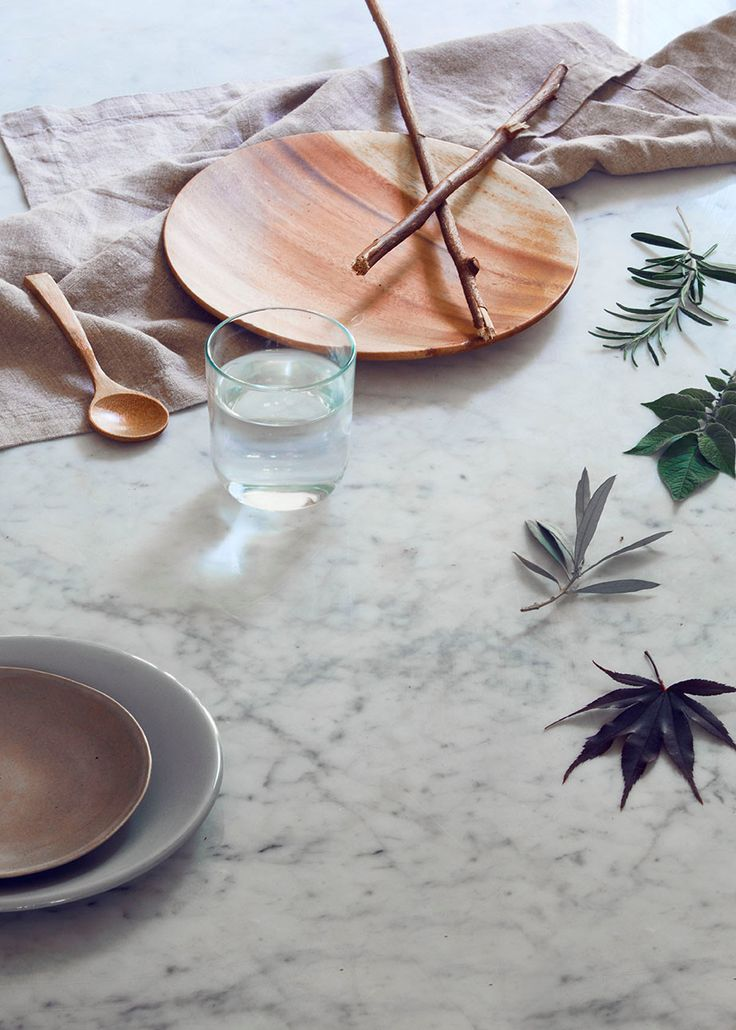 Andrea Mongenie - Interior stylist and prop stylist - dinner styling - dining styling -leaves - linen - green - greenery -marble - water - wood