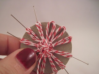 Making Twine Flowers (using cardboard & push pins).  Try with yarn. For Katey
