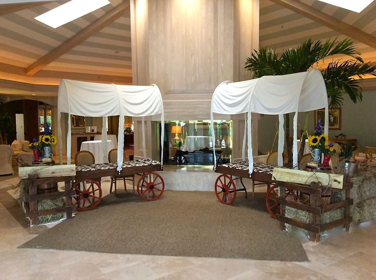 Western themed party decorations.  Chuck wagon check-in tables built around a 6' banquet tables.  Designed by Steven Bowles Creative, Naples, Florida, Florist and Event Designer. www.stevenbowlescreative.com
