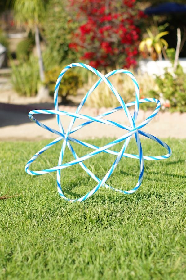 mid way point in a DIY hula hoop hanging light by Emily Henderson, but I love this shape for garden art