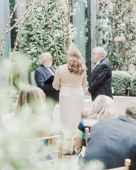 Intimate summer wedding in Bluebell Garden at Proximity Hotel   Photo: Lynn Eisenman Photography