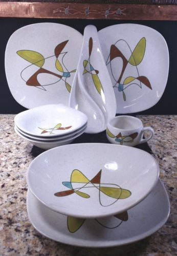1950's vibrant colorful vintage Atomic Aztec Eames MCM Era PoppyTrail/Metlox/Vernon California Free Form Pottery 9 piece set that includes a hard to find Jelly and Jam Dish, Flat Coffee/Tea Cup, Vegetable Serving Bowl, Coupe Soup/Salad Bowls and Salad/Dinner/Bread/Butter Platter Plates. Very good pre-owned vintage condition!