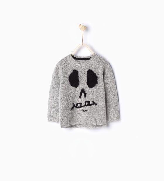 Tricot trui met doodshoofd