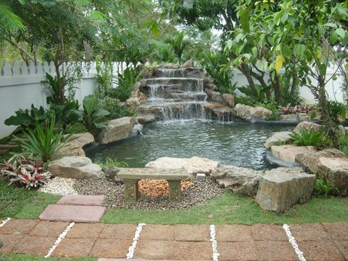 Best 25 rock waterfall ideas on pinterest for Garden design with pond and waterfall
