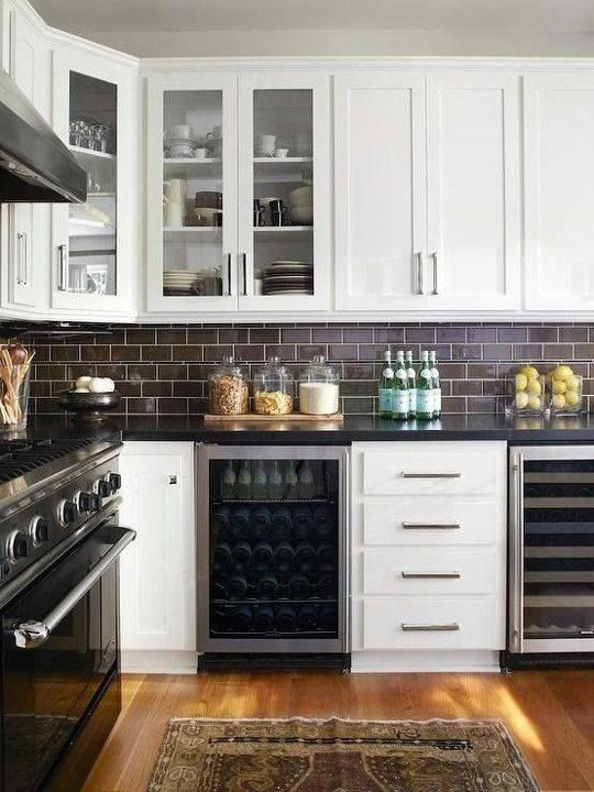 Budget friendly black granite, white shaker style cabinet, subway tile, long skinny drawer and door pulls